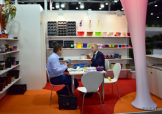 Dietrich Buchmuller of Pppelmann TEKU talking with a visitor. They are exhibiting their products at the German pavillion.