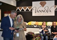 Dennis Hartman Karina Alalykina from Vannova are pretty busy talking about their flowers.