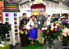 Isaac Salazar of Excellent flowers together with two models in traditional clothing from Cayambe. Excellent Flowers grows fresh roses and preserved. Their farm is 5ha and their main market the US.