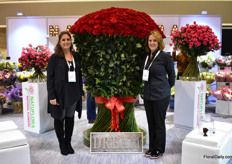 Amy Desperito and Mily Iglesias of Natural Flowers standing next to the Freedom red rose with a hight of ove 6 feet. This Colombian farm, that is primarily a rose grower and known for Freedom, has offices in the US, Hapan and Russia. The US is their main market and according to Iglesias, they are leading in hand tied bouquets.