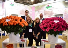 Team of NIRP International. Copacabana (orange rose on the left) and Hotspot (pink rose on the right) take center stage at their booth. Both varieties are doing well in Kenya and South America.