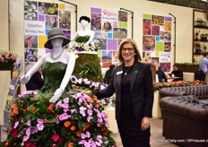 Gill Corless of Sakata next to the dress made out of Sunpatiens.