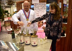 Cook Theo Clevers and grower Willianne Sluiter, from Incredible Roses baptizing the rose named The Clevers.