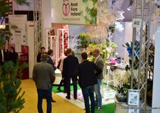 The team of Royal FloraHolland talking with visitors.