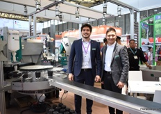 "Manuel Linke and Lun Li presenting the potfiller TM 1010F, one of the three machines they are presenting at the exhibition. Last year, they opened their own sales office with technical support in Nanjing . According to Manuel, for the Chinese growers, it is now time to think about automatic solutions. ""In several areas of the country, lobar costs are rising, so automatic processes becomes more interesting. The TM 1010F is interesting for the Chinese grower as many parts that are now being done manually are automated. It prepares the pots so that the young plants can be put in manually. The only manual labor is putting in the young plants. It can processes 4,000 pots per hour."""