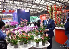"Sander Smeding of Anthura promoting the smaller sized anthurium and phalaenopsis. ""For gifts, often a large plant with the typical colors - like a big red anthurium- are given. Now, the Chinese consumer needs to learn to buy plants for own use and then, we see a shift in demand towards the smaller products and in different colors. Also for the phalaenopsis, we try to introduce a 2 to 3 branched plant. Currently, the phalaenopsis market consists of cheaper 1- stemmed products. Arrangements are then made with more products."""