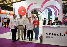 "The team of Selecta One presenting the 'Love Story' concept. This concept is launched in China and destined for the Chinese market only. It is based on the Dianthus we have in our assortment. ""We have Peach Party, Early Love, Pink Kisses and Purple Wedding. Together, in a chronical order it creates a nice love story. So, we made a box in which we put 4 12 cm plants that consumers can order online. In China online ordering is growing and becoming increasingly popular."""