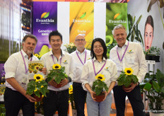 "The team of Evanthia presenting the Sunsation, one of their varieties that is in high demand in China at the moment. ""The Chinese are fond of sunflowers."""