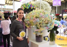 Tasya Kravchenko of Florisol. At the Pro Ecuador booth, they present their tinted roses and gypsophilas. They are eager to export to China and so far, the tinted gypsophila attracted the most attention.