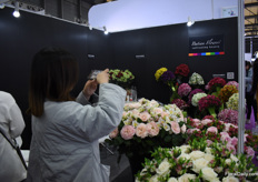 Pictures being taken at the booth of Batian Flowers.