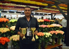Girish Appanna of Fontana presenting their two awards; bronze and gold in the category Best Garden Roses.
