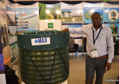 Moses Khaemba of Irrico presenting the Maji Water Storge.