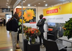Seth Riungu of Aquila talking with visitors. They started out as a rose grower, but over the years, they started to grow more flowers and they are now able to make bouquets on source, something that is in high demand now.
