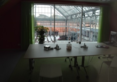 A glimpse from one of the offices to the production greenhouse.