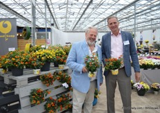 "Jürgen von den Driesch and Jeroen de Kuijer of Brandkap presenting the new Tropic Lantana Varieties. Von den Driesch is the Tropic Lantana Dragonfruit (dark pink/creme) and Kuijer Tropic Lantana Pepper (red). In the pallet, on the left: the third novelty in this series; Tropic Lantana Pitaya (red/orange). ""Pitaya and Pepper will replace Red Lory as these varieties grow much more unique, make more flowers and brighter flowers than Red Lory. Dragonfruit, is a completely new color in our range. The color is just like that of that fruit."""