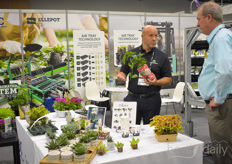 Lars Jensen with Blackmore explaining about the various solutions for growers to a visitor on the Cultivate show