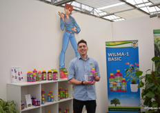 Jur Cooijmans of Wilma's Lawn and Garden showing their new cutflower nutrition.