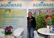 Isabella Poessfrom MPS Agriware at the exibition with several orchids from the grower Optiflor wich has joined their customer base.