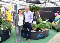 Ayelet Shevah and Peter Collins of Botanics International in front of the Hishtil Plants that are on display at the Botanics international booth.
