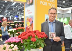 "Klaus Wolf of Rosen Tantau presenting True Love, a new red variety for which Wolf sees a large potential to be grown in Russia. ""The flower size is big, it has a dark red color, stem length 70-90cm, no problems with fungus, is big in summer time and has vase life of 10-12 days."" It has been tested by several growers and everyone was positive, he explains."