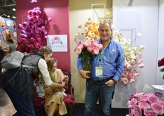 Jose Azout of Alexandra farms in front of the flower arrangement that is made by the Moscow Flower School.