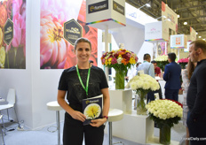 "a Kravchenko of Florisol proudly presenting Magnum, ""Our biggest chrysanthemum we have"""
