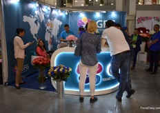 Busy at the booth of Grand Flowers Group, a logistic Russian company.