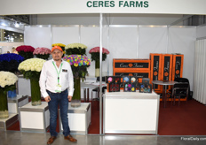 Patricio Ruiz of Ceres Farms with, among others, their painted roses.