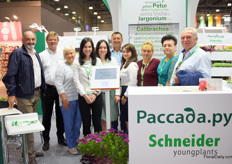 Anton Schneider from Schneider youngpants, second left, together with the whole team of Russian partner company Paccada.