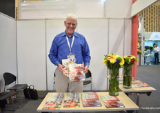 David Coake of SuperFloral, Florist's Review and Canadian Florist presenting their magazines.