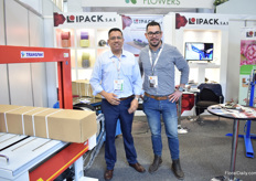 Fredy Rincon and Carlos Rico of Ipack presenting their cardboard binding machine.
