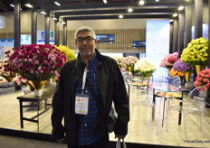 Salaiman Aloqaibi of United Flowers in front of The Elite Flowers, the farm of which he imports the most flowers from. Aloqaibi was visiting the show.