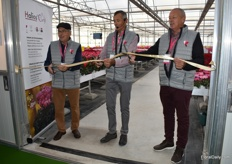 Brothers Guy, Olivier, Paul-Henri opening the new greenhouse by cutting the ribbon.