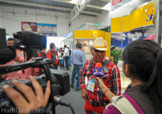 A local Mexican TV station interviewing visitors of the show.
