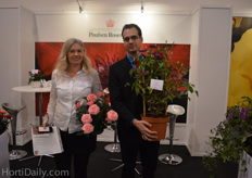 Ghita Krage and Mario Kurt Gigerl from Poulsen Roser holding a new pot rose variety and an indoor clematis.
