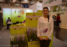 """Sarah L. Corselis from Okidland France Biotechnology in front of the ""gift tube""."""
