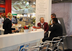 Nick Luiten (Luiten Greenhouses) talking to guests in their booth